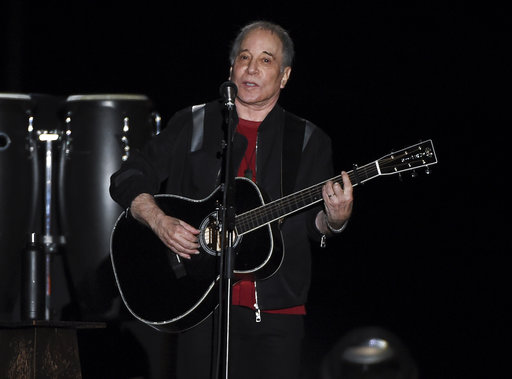 Singer-songwriter Paul Simon performs in Flushing Meadows Corona Park during the final stop of his Homeward Bound - The Farewell Tour concert on Saturday, Sept. 22, 2018, in New York. (Photo by Evan Agostini/Invision/AP)