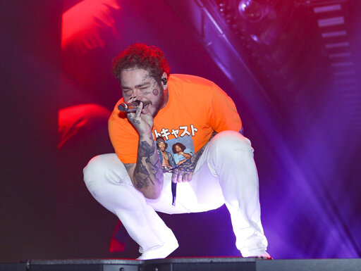 Post Malone performs at Infinite Energy Center on Tuesday, March 3, 2020, in Atlanta. (Photo by Robb Cohen/Invision/AP)
